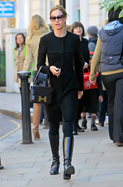 Trinny Woodall went for a stroll looking dressy in an LBD, knee-high boots, and an Hermes bag.