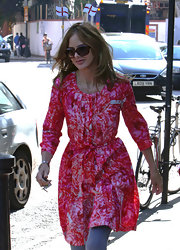 Trinny Woodall looked more like she was attending a party than going on the school run in this stylish pink print dress.