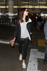 Troian Bellisario sealed off her look with black leggings.