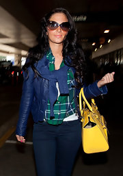 Tulisa Contostavlos added pop to her preppy look with a bright yellow tote.