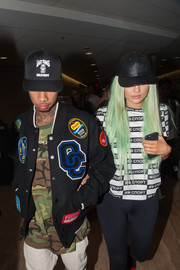 Kylie Jenner kept a low profile with a black leather baseball cap while making her way through LAX.