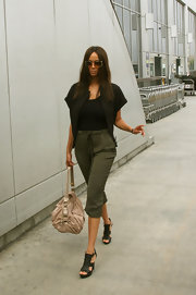 A slouchy tan leather bag like Tyra's is a smart style staple.