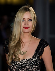 Laura Whitmore fixed her corkscrew curls in a side sweep for the UK premiere of 'The Hunger Games.'