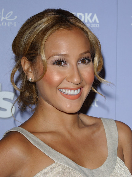 Adrienne Bailon styled her curls into a low hanging bun. She topped things off with lengthy lashes.