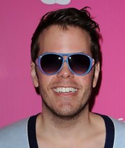 Perez Hilton actually looked cool with his slightly messy 'do and and blue-framed sunnies at the US Weekly Hot Hollywood event.
