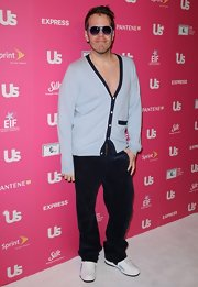 Perez Hilton attempted a sexy look with a deep-V cardigan and black corduroys at the US Weekly Hot Hollywood event.