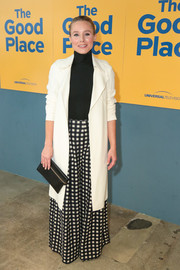 Kristen Bell teamed a pair of grid-print wide-leg pants by Ulla Johnson with a black turtleneck for the FYC screening of 'The Good Place.'