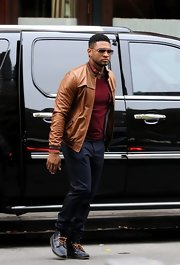 Usher looked slick in a brown leather jacket for an outing in Tribeca.