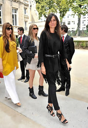 Emmanuelle Alt showed off her slender feet in a pair of black strappy heats with silver grommets as she attended the Valentino Haute Couture show.