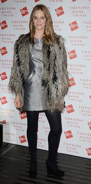 Trinny Woodall layered a feather jacket over a silver sheath for a super chic finish at the Valentino: Master of Couture exhibition.