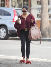 Vanessa Hudgens kept her feet super comfy in a pair of Brother Vellies marabou slide sandals.