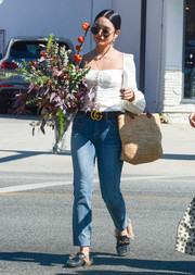 Vanessa Hudgens completed her ensemble with a straw tote.