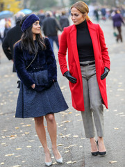 Jennifer Lopez looked stylish on the set of 'Second Act' in a red coat layered over a black turtleneck.