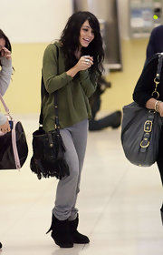 "Celebs love the ""Flat Jack"" fringe messenger bag. Vanessa's black version is great for everyday use."
