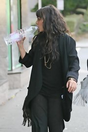 Vanessa Hudgens layered an oversize black blazer over lounge pants and a T-shirt.