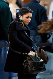 Vanessa Hudgens was spotted at LAX carrying a black leather crossbody bag.