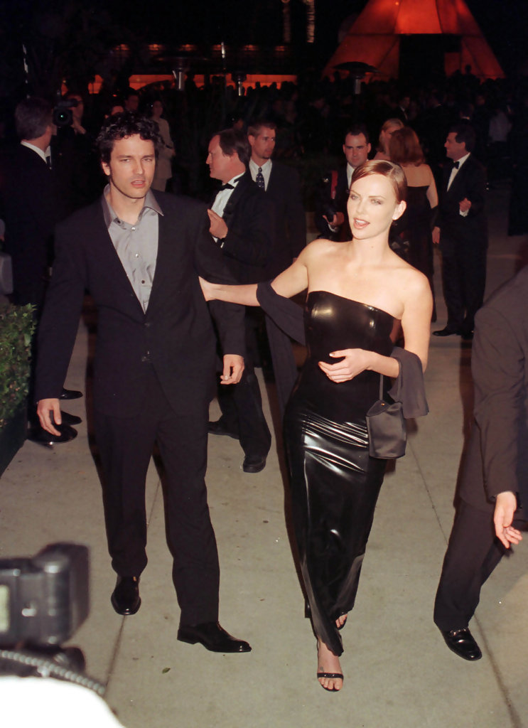 Vanity Fair post-Oscar party at Morton's restaurant in Los Angeles, CA.Pic shows: Charlize Theron and boyfriend Stephan Jenkins of Third Eye Blind.March 21, 1999.
