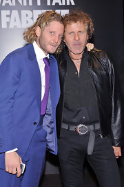 Lapo Elkann wore a purple knit tie with his blue suit for a colorful finish during the Vanity Fair FabFive party.