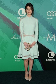 Lizzy Caplan was modest yet lovely at the Variety Power of Women event in a long-sleeve mint-green Elie Saab shirtdress. Sheer lace panels down the sleeves and along the waistline and hemline added just the right amount of sexy, feminine appeal.