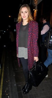 Laura Carmichael was spotted outside the Vaudeville Theatre carrying an oversized leather satchel.
