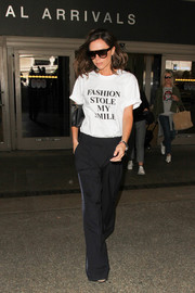Victoria Beckham finished off her outfit with a pair of side-striped slacks.