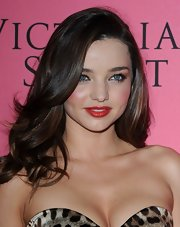 Miranda Kerr wore a shiny warm red lipstick at the Victoria's Secret fashion show viewing party.