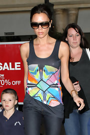 Victoria sported a retro pair of two-toned shades with her colorful tank top.