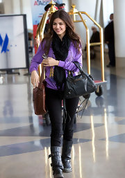 Victoria was seen at LAX carrying a black leather biker tote.