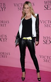 Kym Johnson showed her sporty side in these leather racer stripe pants on the pink carpet of the Victoria's Secret 'What Is Sexy?' party.