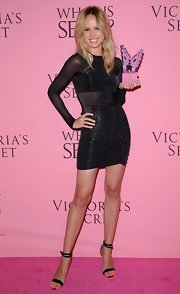 Elin Kling showed some skin at the Victoria's Secret 'What Is Sexy?' party in this sparkly mesh cocktail dress.