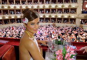 Helena Christensen attended the Vienna Opera Ball wearing her hair in a loose bun with side-swept bangs and a delicate orchid accent.