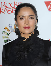 Salma infused her all black look with a pop of vivid color. Her matte red lipstick was the perfect way to add a little sexy to her look.
