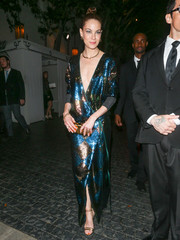 Michelle Monaghan enjoyed a night out wearing strappy gold heels and a sequined wrap gown.