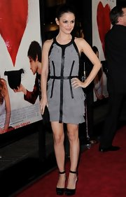 a4823c76a0cb Cocktail Dress. Rachel Bilson. Rachel looked like she stepped off the  runway in her gray ruffled frock with stark black