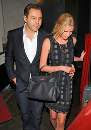 Looking all too demur, Lara Stone showed off a classic leather tote bag.