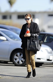 Kate Walsh kept cozy while running errands in a thick black duster sweater and olive khakis.