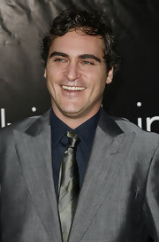 Joaquin's tress method? Slather on gel, mess up hair, leave as is. And he makes messy look good.