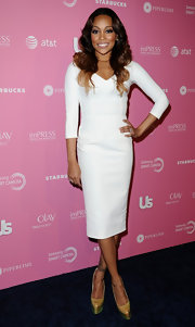 It doesn't get sexier than a sleek white dress like Monica's at the Hot Hollywood fete.