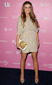 Carmen jazzed up her beige dress at the Hot Hollywood event with this beaded leather clutch.
