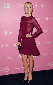 Julianne Hough paired her sexy dress with a pair of black and pink peep toe platform pumps with slim ankle straps.