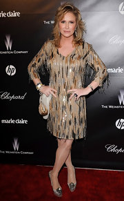 Kathy Hilton went to the Weinstein Company Golden Globes party wearing a stylish beaded shift dress.