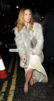 Juno Temple was elegant and totally glamorous in a classic fur coat at the BAFTA after party.