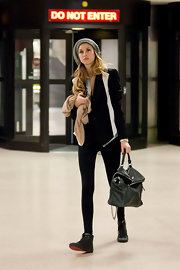 Whitney Port trekked through LAX in style in trendy leather lace up flats. The shoes matched the indie vibe of her knit beret and skinny jeans.