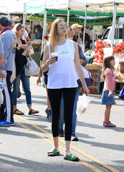 Whitney Port completed her outfit with a pair of green Nike slides.