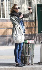 While hailing a cab on a New York City street Whitney Port showed off her edgy street style. Her large hobo bag was the stand out piece, however.
