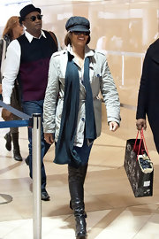 Whitney Houston walked at the lobby of LAX wearing a pair of leather over-the-knee boots.