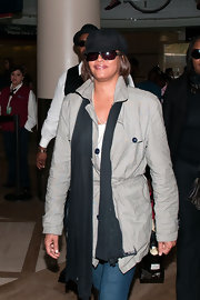 Whitney Houston placed a solid scarf under her jacket's collar as she departed from LAX.