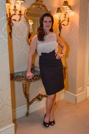 Brooke Shields paired her girly blouse with a high-waisted black pencil skirt.