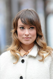 Olivia Wilde wore her hair in long waves with side-swept bangs while on the set of 'The Longest Week.'