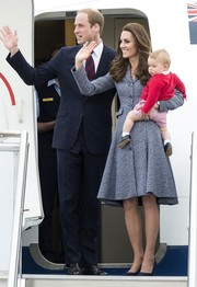 Kate Middleton chose a classic gray Michael Kors coat dress for her flight back to London after her Australia tour.